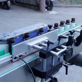Dettagli dell'etichettatrice automatica dell'autoadesivo della bottiglia rotonda verticale
